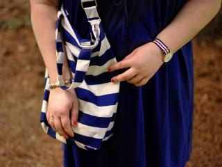 Navy dress and a striped bag